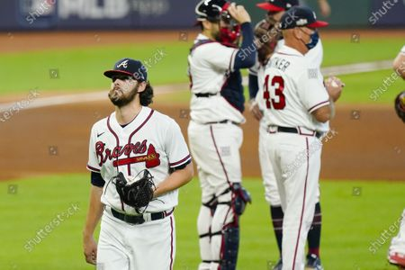 Atlanta Braves starting pitcher Ian Anderson, left, leaves during the sixth inning in Game 2 of a baseball National League Division Series against the Miami Marlins, in Houston