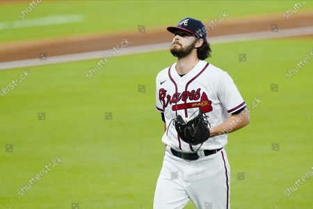 Atlanta Braves starting pitcher Ian Anderson leaves during the sixth inning in Game 2 of a baseball National League Division Series against the Miami Marlins, in Houston
