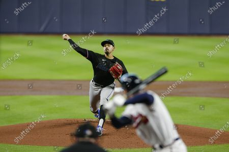 Miami Marlins' Pablo Lopez delivers a pitch to Atlanta Braves' Freddie Freeman in Game 2 of a baseball National League Division Series, in Houston