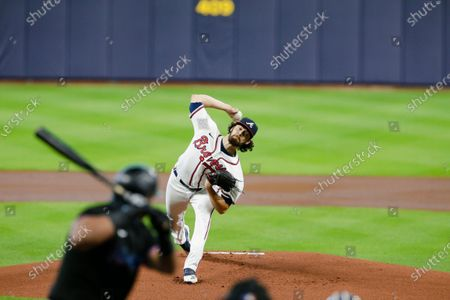 Atlanta Braves' Ian Anderson delivers a pitch during the first inning in Game 2 of a baseball National League Division Series against the Miami Marlins, in Houston