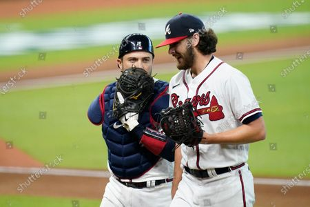 Atlanta Braves starting pitcher Ian Anderson, right, talks to catcher Travis d'Arnaud after the second inning in Game 2 of a baseball National League Division Series against the Miami Marlins, in Houston