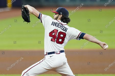 Atlanta Braves' Ian Anderson delivers a pitch during the fourth inning in Game 2 of a baseball National League Division Series against the Miami Marlins, in Houston