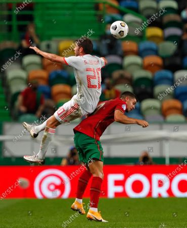 Spain's Sergi Roberto climbs above Portugal's Andre Silva during the international friendly soccer match between Portugal and Spain at the Jose Alvalade stadium in Lisbon