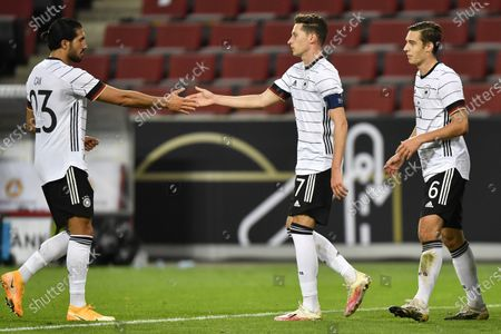 Germany's Julian Draxler, center, celebrates after scoring his side's opening goal with Germany's Emre Can during the international friendly soccer match between Germany and Turkey in Cologne, Germany