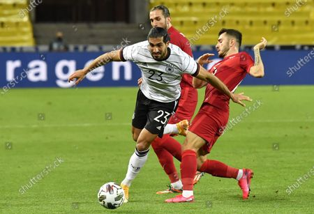 Germany's Emre Can, left, is challenged by Turkey's Kenan Karaman during the international friendly soccer match between Germany and Turkey in Cologne, Germany