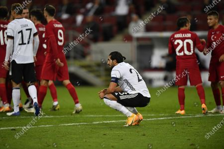 Stock Photo of Germany's Emre Can gestures end of the international friendly soccer match between Germany and Turkey in Cologne, Germany