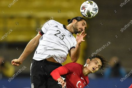 Germany's Emre Can, left, heads the ball past Turkey's Enes Unal during the international friendly soccer match between Germany and Turkey in Cologne, Germany