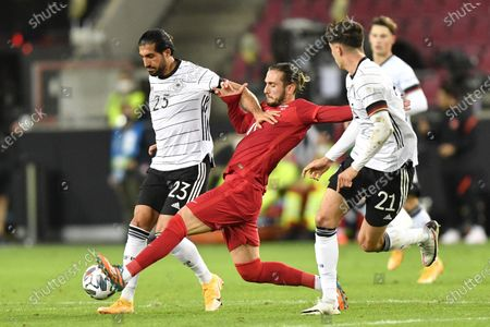 Turkey's Yusuf Yazici, center, fights for the ball with Germany's Emre Can, left, and Germany's Kai Havertz during the international friendly soccer match between Germany and Turkey in Cologne, Germany