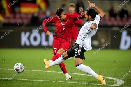 Turkey's Cengiz Uender (L) in action against Germany's Emre Can (R) during the international friendly soccer match between Germany and Turkey at Rheinenergiestadion in Cologne, Germany, 07 October 2020.