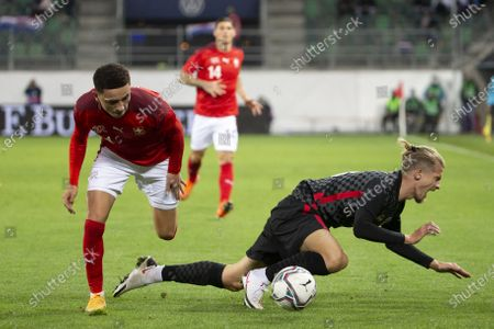 Switzerland's midfielder Ruben Vargas (L) fights for the ball with Croatia's defender Tin Jedvaj during the international friendly soccer match between the national soccer teams of Switzerland and Croatia, at the Kybunpark stadium in St. Gallen, Switzerland, 07 October 2020.