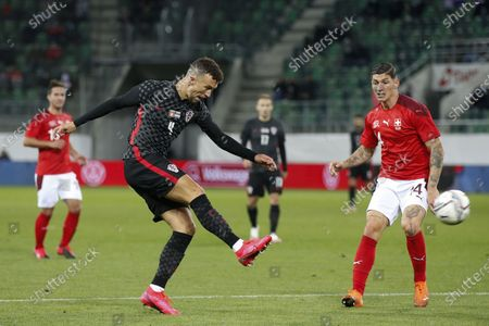 Switzerland's Steven Zuber (R) and Croatia's Ivan Perisic in action during the international friendly soccer match between the national soccer teams of Switzerland and Croatia, at the Kybunpark stadium in St. Gallen, Switzerland, 07 October 2020.