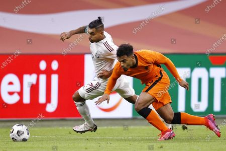 Stock Image of Jesus Manuel Corona (L) of Mexico and Owen Wijndal of the Netherlands in action during the international friendly soccer match between the Netherlands and Mexico at Johan Cruyff Arena in Amsterdam, the Netherlands, 07 October 2020.