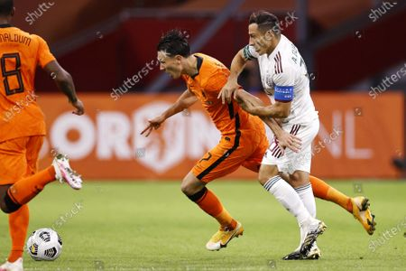 Steven Berghuis (L) of the Netherlands and Jose Andres Guardado Hernandez of Mexico in action during the international friendly soccer match between the Netherlands and Mexico at Johan Cruyff Arena in Amsterdam, the Netherlands, 07 October 2020.