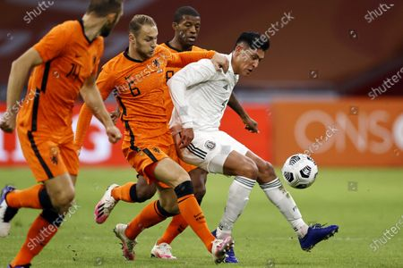 Dutch player Teun Koopmeiners (C) and Edson Alvarez (R) of Mexico in action during the international friendly soccer match between the Netherlands and Mexico at Johan Cruyff Arena in Amsterdam, the Netherlands, 07 October 2020.