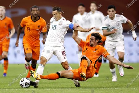 Jose Andres Guardado Hernandez (L) of Mexico and Dutch player Hans Hateboer in action during the international friendly soccer match between the Netherlands and Mexico at Johan Cruyff Arena in Amsterdam, the Netherlands, 07 October 2020.