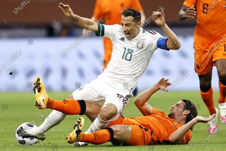 Jose Andres Guardado Hernandez (L) of Mexico is tackled by Dutch player Hans Hateboer during the international friendly soccer match between the Netherlands and Mexico at Johan Cruyff Arena in Amsterdam, the Netherlands, 07 October 2020.