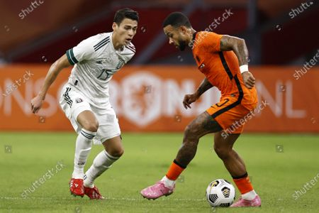 Hector Moreno (L) of Mexico and Dutch player Memphis Depay in action during the international friendly soccer match between the Netherlands and Mexico at Johan Cruyff Arena in Amsterdam, the Netherlands, 07 October 2020.