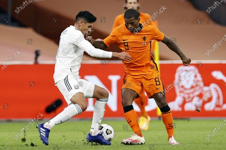 Edson Alvarez (L) of Mexico and Georginio Wijnaldum of the Netherlands in action during the international friendly soccer match between the Netherlands and Mexico at Johan Cruyff Arena in Amsterdam, the Netherlands, 07 October 2020.