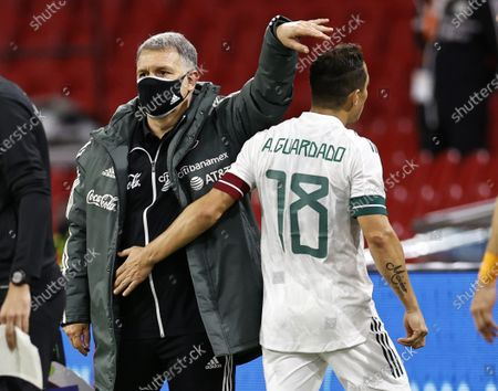 Mexico's head coach Gerardo Martino (L) and his player Jose Andres Guardado Hernandez react during the international friendly soccer match between the Netherlands and Mexico at Johan Cruyff Arena in Amsterdam, the Netherlands, 07 October 2020.