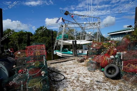 Crab traps that were pulled upon anticipation of Hurricane Delta, and a shrimp boat that is docked, are seen on Bayou Dularge, expected to arrive along the Gulf Coast later this week, in Theriot, La