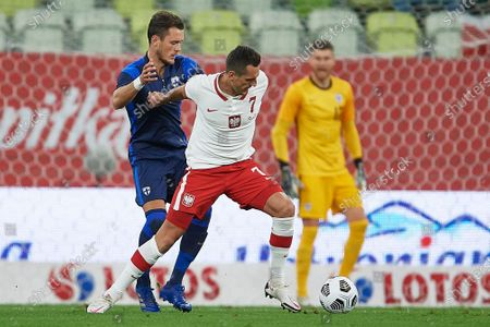 Arkadiusz Milik (C) of Poland in action against Finland's Thomas Lam (L) during the international friendly soccer match Poland vs Finland at Energa stadium, in Gdansk, Poland, 07 October 2020.