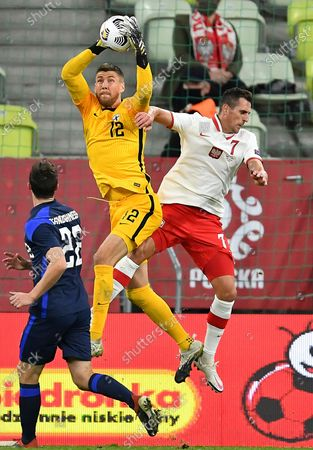 Arkadiusz Milik (R) of Poland in action against Finland's goalkeeper Jesse Joronen (C) during the international friendly soccer match Poland vs Finland at Energa stadium, in Gdansk, Poland, 07 October 2020.