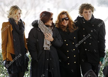 Priscilla Presley, second from left, her daughter, Lisa Marie, second from right, and Lisa Marie's children, Riley Keough, 21, left, and Benjamin Keough, 18, right, take part in a ceremony commemorating Elvis Presley's 75th birthday, in Memphis, Tenn. Officials said Wednesday, Oct. 7, 2020, that Benjamin Storm Presley Keough has been buried alongside his relatives at Graceland in Memphis. Keough died in California in July at age 27