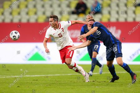 Arkadiusz Milik of Poland and Leo Vaisanen of Finland compete for the ball during the international friendly match between Poland and Finland at PGE Arena