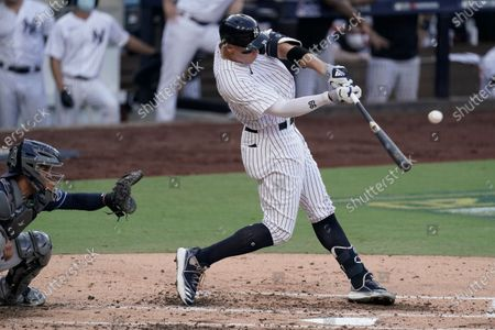 New York Yankees' Aaron Judge (99) hits a sacrifice fly to allow Brett Gardner to score against the Tampa Bay Rays during the third inning in Game 3 of a baseball American League Division Series, in San Diego