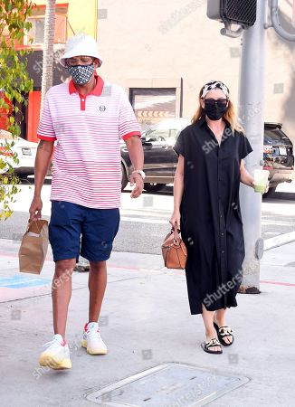 Stock Picture of Ellen Pompeo and Chris Ivery are seen picking up food to-go