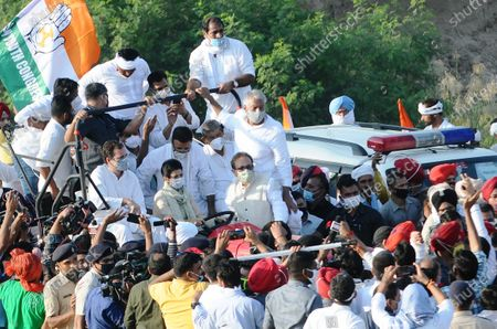 Congress leader Rahul Gandhi, Selja Kumari and Bhupinder Singh Hooda during a tractor rally, 'Kheti Bachao Yatra', in protest against the new farm laws  on October 6, 2020 in Pehowa, India.