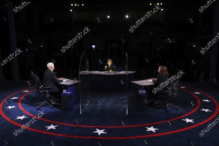 Vice President Mike Pence and Democratic vice presidential candidate Sen. Kamala Harris, D-Calif., listens to a question from moderator USA Today Washington Bureau Chief Susan Page during the vice presidential debate, at Kingsbury Hall on the campus of the University of Utah in Salt Lake City