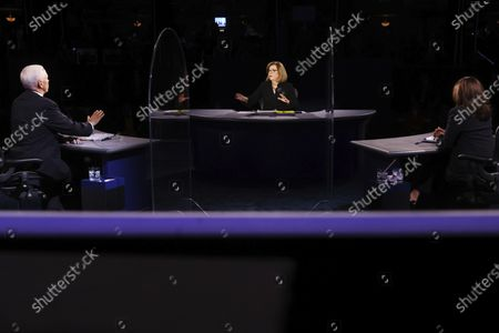Vice President Mike Pence and moderator USA Today Washington Bureau Chief Susan Page speaks as Democratic vice presidential candidate Sen. Kamala Harris, D-Calif., listens during the vice presidential debate, at Kingsbury Hall on the campus of the University of Utah in Salt Lake City