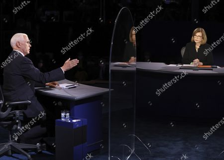 Vice President Mike Pence speaks as moderator USA Today Washington Bureau Chief Susan Page listens during the vice presidential debate, at Kingsbury Hall on the campus of the University of Utah in Salt Lake City