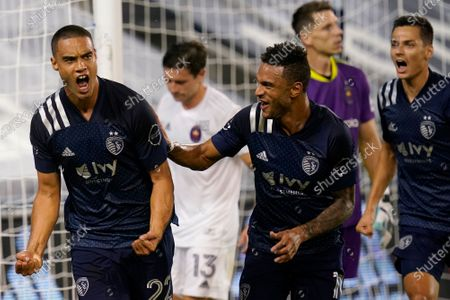 Sporting Kansas City defender Winston Reid (22) celebrates his goal with Khiry Shelton (11) during the second half of the team's MLS soccer match against the Chicago Fire in Kansas City, Kan., . Sporting KC won 1-0