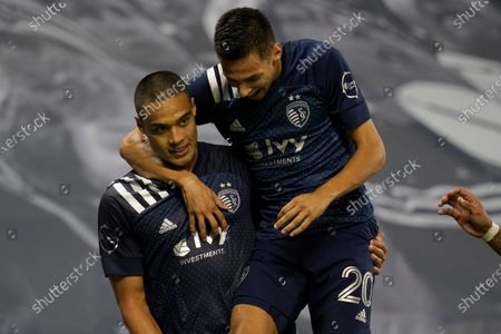Stock Picture of Sporting Kansas City defender Winston Reid, left, is congratulated by Daniel Salloi (20) after his goal during the second half of the team's MLS soccer match against the Chicago Fire in Kansas City, Kan., . Sporting KC won 1-0