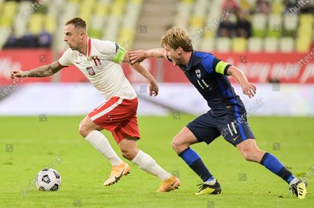 Kamil Grosicki of Poland (L) and Rasmus Chuller of Finland (R) are seen in action during a football friendly match between Poland and Finland at the Energa Stadium in Gdansk. (Final score; Poland 5:1 Finland)