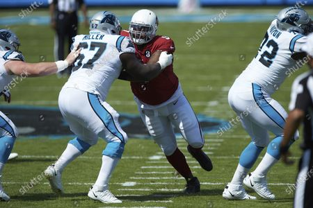 Arizona Cardinals defensive end Jordan Phillips (97) wors against Carolina Panthers guard John Miller (67) during an NFL football game, in Charlotte, N.C