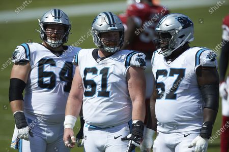 L-R) Carolina Panthers offensive lineman Chris Reed (64), Matt Paradis (61) and John Miller (67) during an NFL football game against the Arizona Cardinals, in Charlotte, N.C