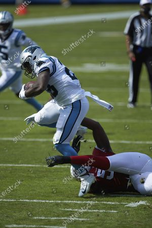 Carolina Panthers running back Mike Davis (28) breaks free of the tackle attempt of Arizona Cardinals linebacker Chandler Jones (55) during an NFL football game, in Charlotte, N.C
