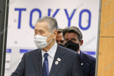 World Athletics President Sebastian Coe, right, and Tokyo 2020 Organizing Committee President Yoshiro Mori, left, head for a meeting in Tokyo . Coe is in the Japanese capital on a courtesy visit to Tokyo Olympics organizers