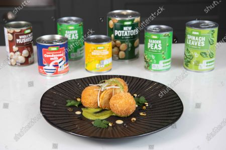 Stock Photo of Forget à la carte it's all about à la can. ASDA and MasterChef's Dean Edwards create a three course tin-spirational meal made from tins for £3.67