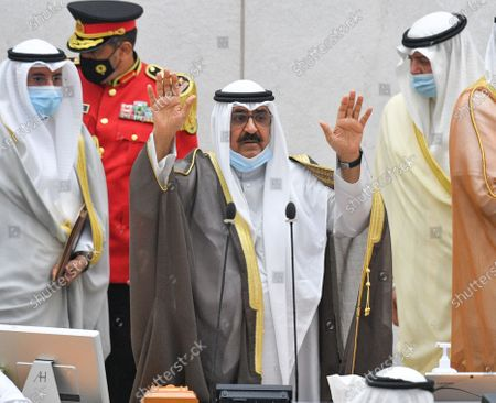 Kuwait Crown Prince Sheikh Mishaal Al-Ahmad Al-Jaber Al-Sabah gestures as he arrives to take the oath of office at the Kuwait Parliament, in Kuwait City, Kuwait, 08 October 2020