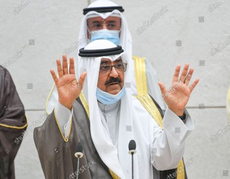 Kuwait Crown Prince Sheikh Mishaal Al-Ahmad Al-Jaber Al-Sabah (R) waves as he arrives to take the oath of office at the Kuwait Parliament, in Kuwait City, Kuwait, 08 October 2020