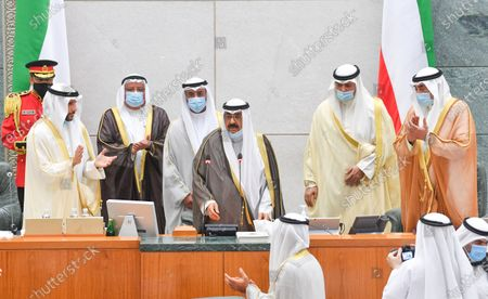 Kuwait Crown Prince Sheikh Mishaal Al-Ahmad Al-Jaber Al-Sabah (C) takes the oath of office at the Kuwait Parliament, in Kuwait City, Kuwait, 08 October 2020