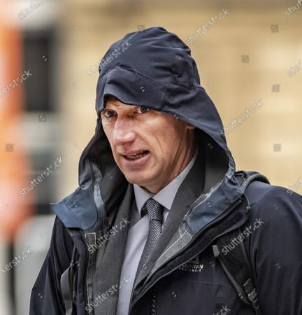 Stock Picture of A solicitor stalked his district judge wife and branded her a 'dirty little slut' after she confessed she was having an affair, a court heard. Scott Ainge, 47, embarked on a 'relentless and determined' campaign of harassment against his wife of ten years, Kate, 41. He allegedly abused his position as a lawyer with the Crown Prosecution Service in Lancashire by accessing confidential files to look into the background of Mrs Ainge's new lover, Andrew Thompson.