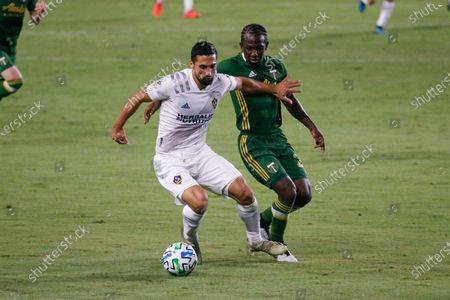 Galaxy midfielder Sebastian Lletget (17) and Portland Timbers midfielder Diego Chara (21) of Colombia, in actions during an MLS soccer match between LA Galaxy and Portland Timbers in Carson, Calif., . The Timbers won 6-3