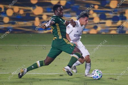 Portland Timbers defender Larrys Mabiala (33) of France, and LA Galaxy forward Cristian Pavon (10) of Argentina, in actions during an MLS soccer match between LA Galaxy and Portland Timbers in Carson, Calif., . The Timbers won 6-3