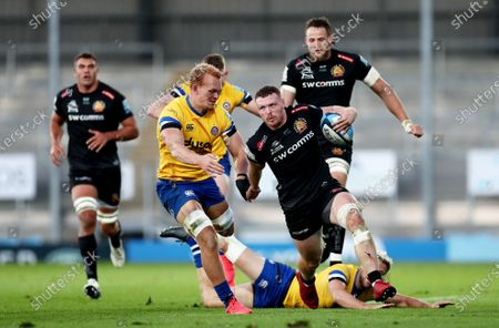 Stock Photo of Sam Simmonds of Exeter Chiefs skips by the tackle of Rhys Priestland of Bath.