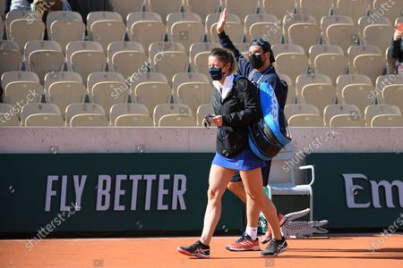 Pauline Parmentier and Amir at Roland Garros stadium